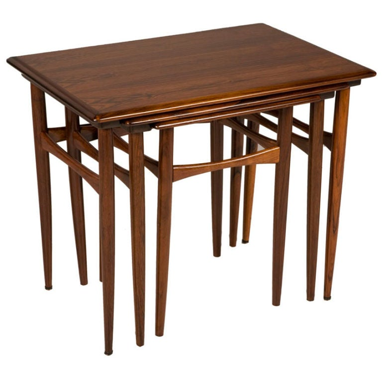 This Set of Three Rosewood Nesting Tables by Kai Kristiansen is no ...