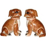 A Pair Of Porcelain Dogs