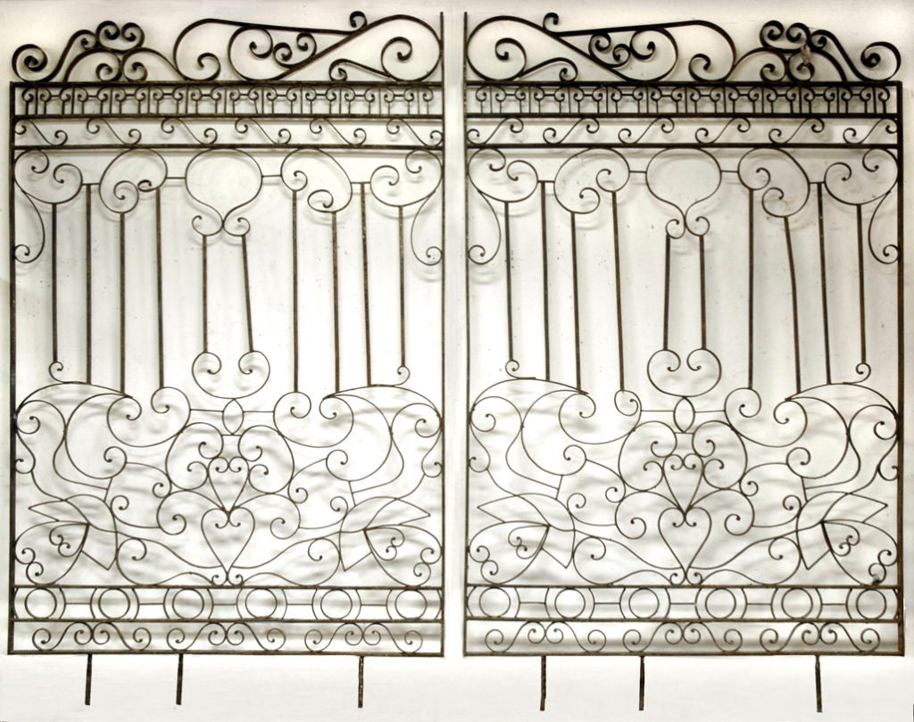 Imposing and striking pair of iron hand forged gates at