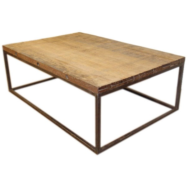 Iron and rustic wood coffee table at 1stdibs Rustic iron coffee table