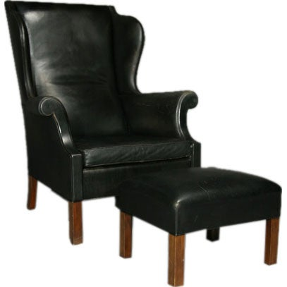 Black leather and teak wingback chair and ottoman at 1stdibs