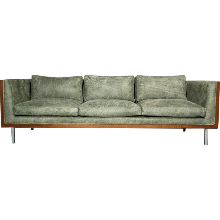 green leather sofa. Black Bedroom Furniture Sets. Home Design Ideas