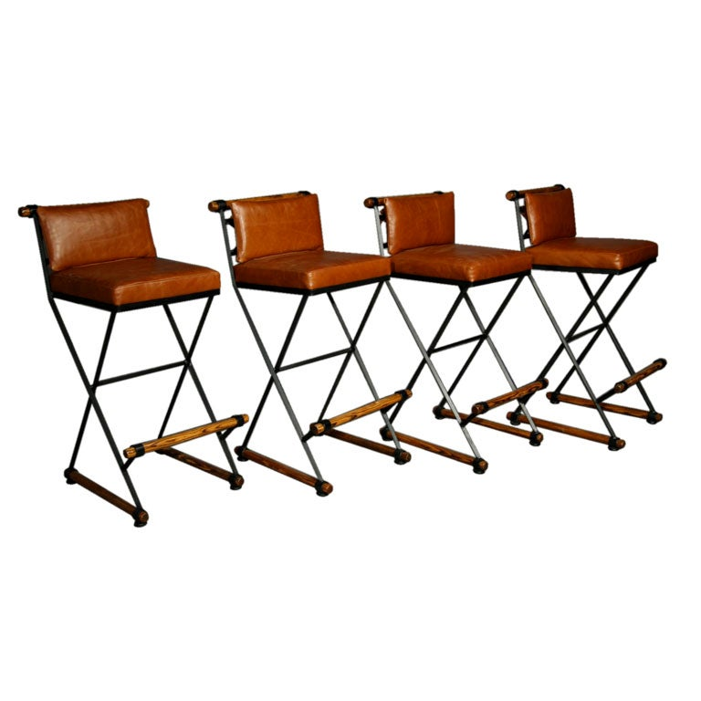 Set of four caramel leather bar stools by Cleo Baldin at  : cleobaldincaramelleatherseatbackbarstools1 from www.1stdibs.com size 768 x 768 jpeg 49kB