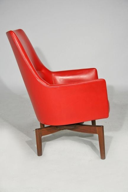 this pair of red leather and walnut lounge chairs by jens risom is no