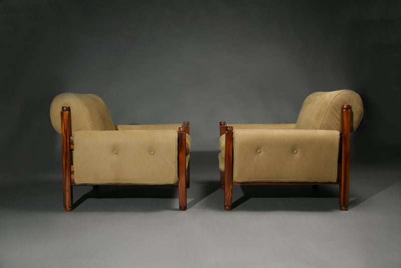 Pair of brazilian exotic wood and tan suede arm chairs at