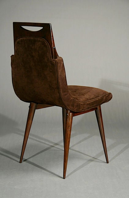 set of eight brown suede and exotic wood dining chairs at