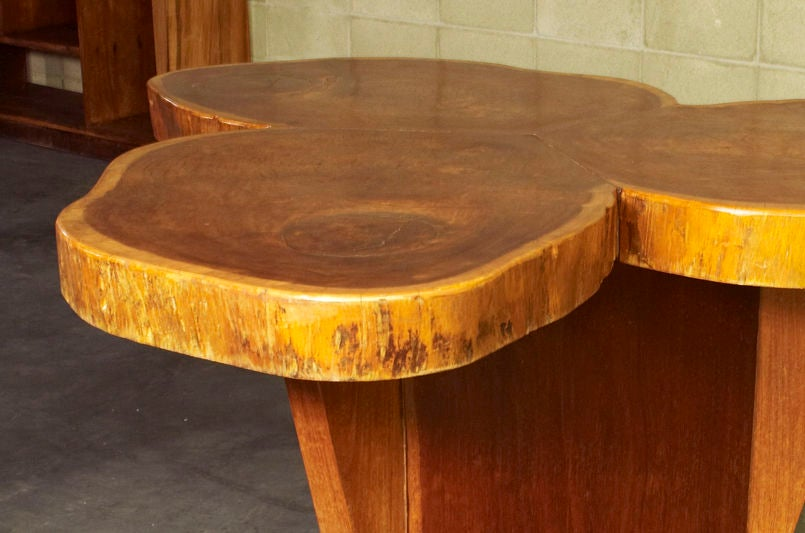 This stunning clover-shaped table byJosé Zanine Caldas illustrates his unique design perspective using existing wood to inform the design of the table without being beholden to it's form. The resulting table is a marvel to behold, yet it retains