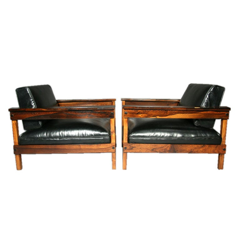 Pair of Brazilian rosewood and black leather lounge chairs at 1stdibs