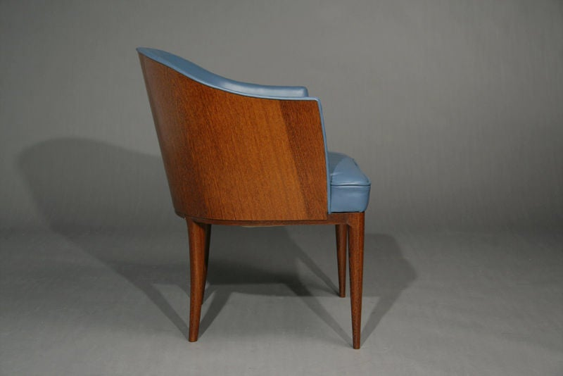 Pair of blue leather and exotic wood barrel chairs at stdibs