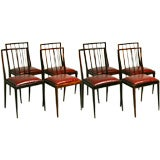 Set of 8 rosewood dining chairs by Jean Gillon