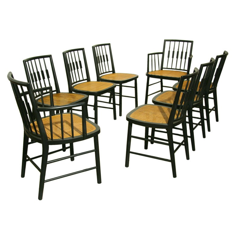 this set of 8 black spindle back dining chairs by baker is no longer
