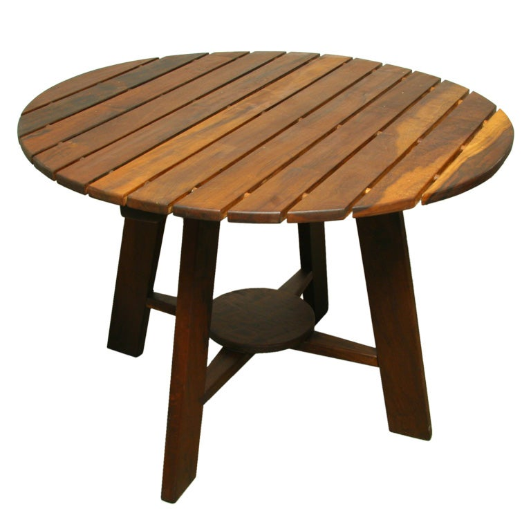 exotic wood round outdoor dining table by sergio rodrigues