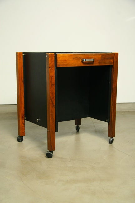 This small rolling side table with a single drawer by Jorge Zalszupin by L'Atelier could be easily integrated into any office. The inside, sides and back are wrapped in original black leather. Many pieces are stored in our warehouse, so please click