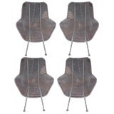 Set of four captains chairs by Woodard 100's of pieces.