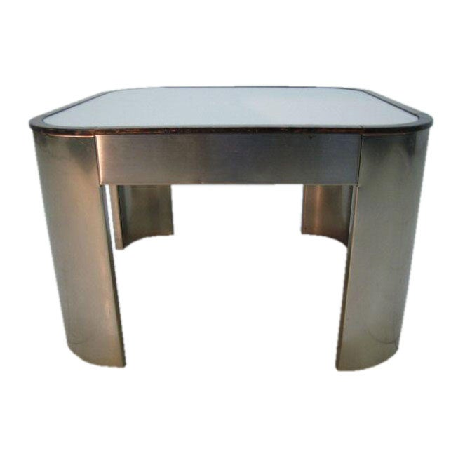A chrome table with a mirrored top and a wood border at for Table no border