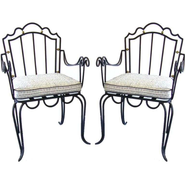Pair of wrought iron arm chairs at stdibs