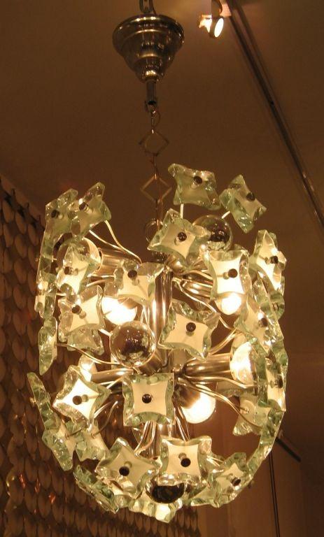 an oval shaped crystal chandelier by fontana arte at 1stdibs. Black Bedroom Furniture Sets. Home Design Ideas
