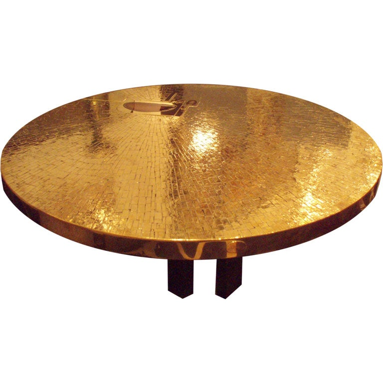 a large round cocktail table in gilt brass by jean claude dr