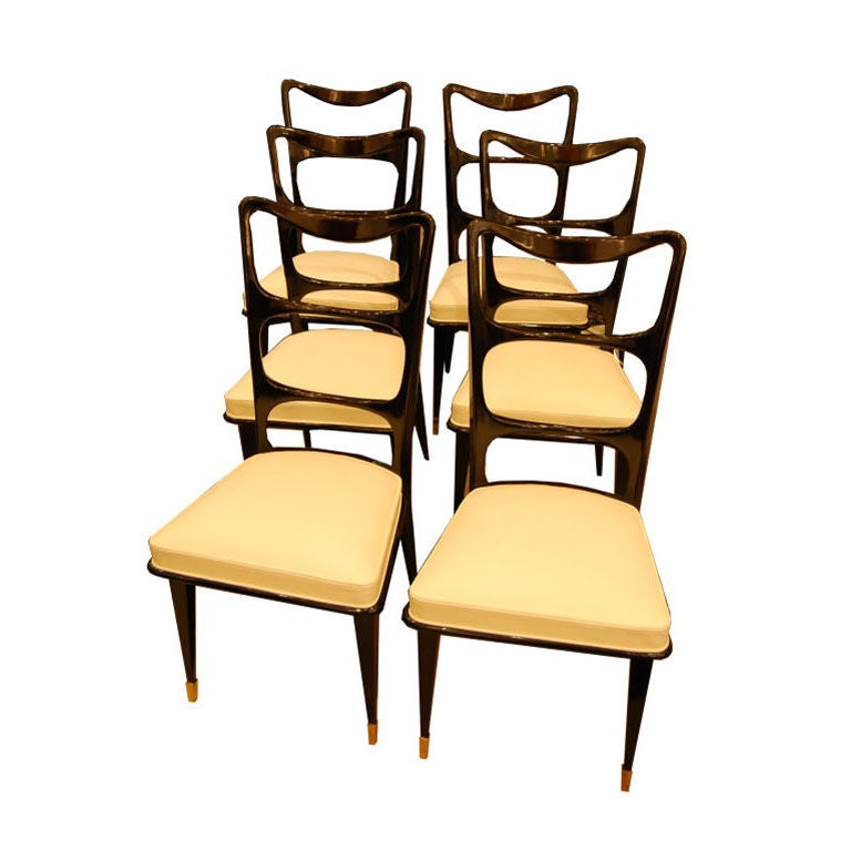 a set of six dining chairs in black lacquer and cream