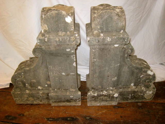 This pair of 19th century French corbels can be used as is in the garden as decorative ornaments. They can also be used as the base to a console when mounted in a wall. This was their original use, projecting from within a wall supporting a weight