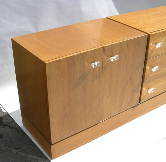 Classic clean lines dominate this 1970's Baughman design. The cabinet is executed in finished ash wood, accented with chrome bands and lucite pulls. The condition is excellent, and retains the original label in the top drawer. The cabinet could be