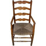 Early 19th Century French Ladderback Arm Chair