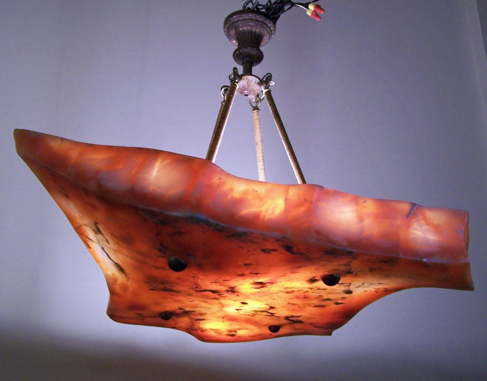 One of a kind hand carved alabaster light with antique hardware. Wonderful shape and fiery color.