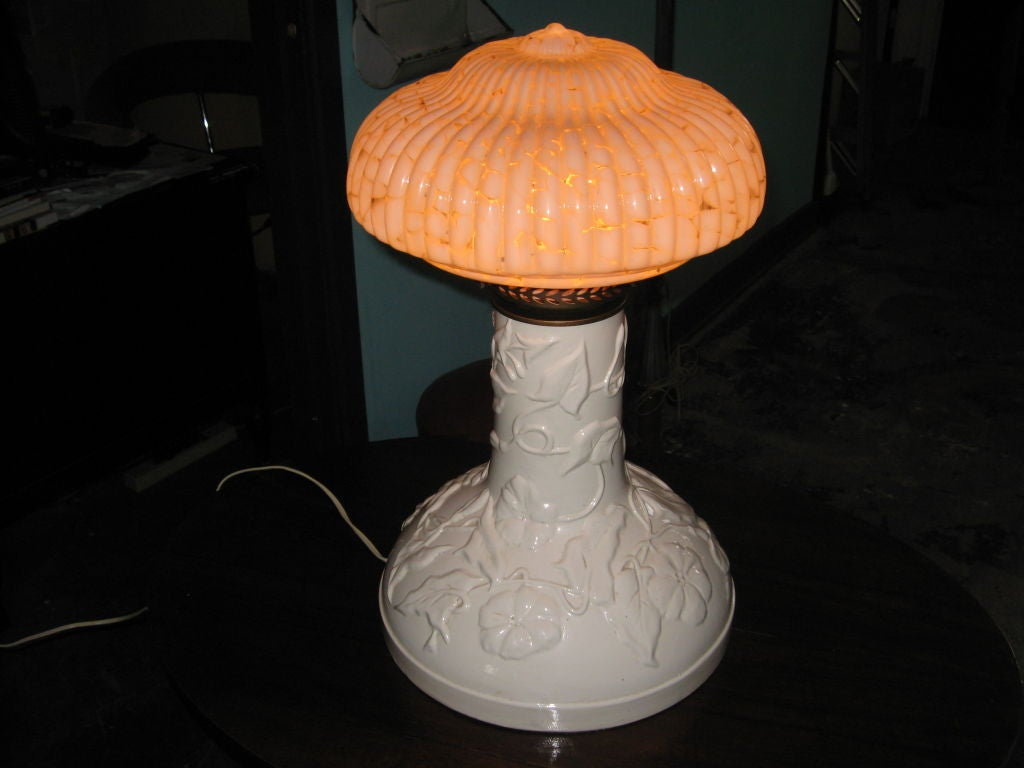 This is a very unique lamp. The base is ceramic and has a g Murano glass shade.