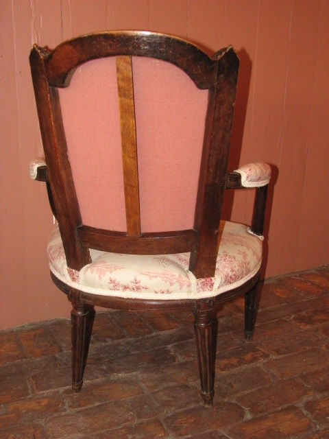 Hand-Carved French Louis XVI Walnut Fauteuil For Sale