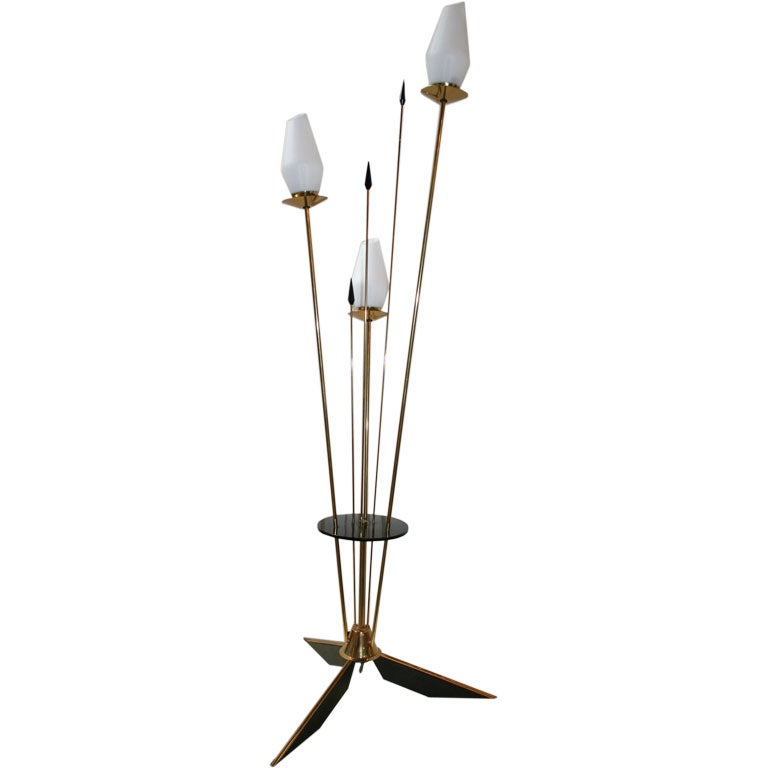1950s French brass and black metal floor lamp with three lights covered by opaque glass.