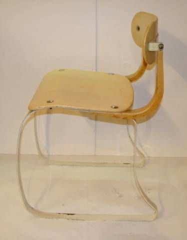 Wonderful example of the Ironrite Health Chair designed by Herman Sperlich in 1938.  We like this better than the one in MOMA's design collection due to its absolute originality.<br />