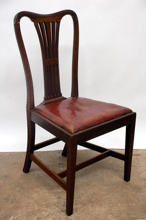this set of 4 large english aged leather dining chairs is no longer