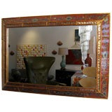 MIRROR WITH REVERSE HAND PAINTED GLASS  FRAME.