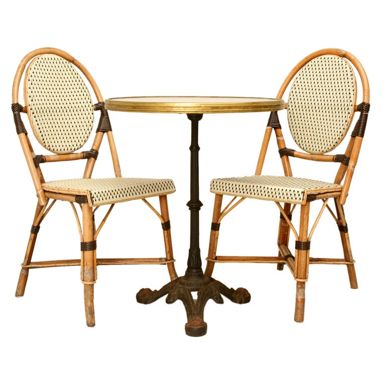 this french bistro table paired w bamboo chairs is no longer