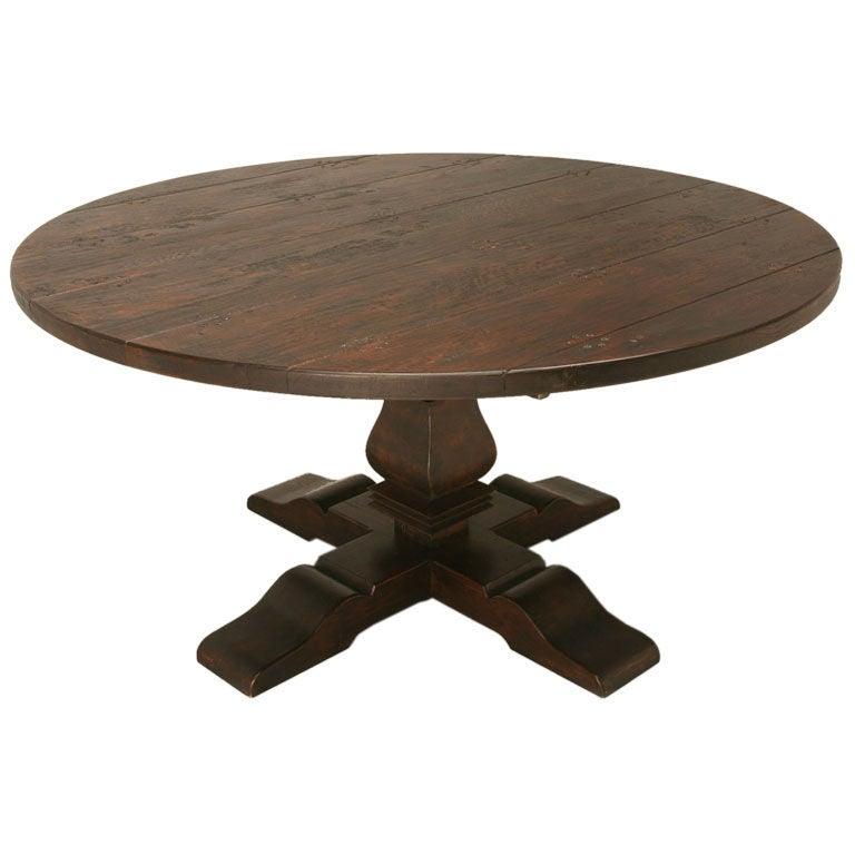 Round oak pedestal dining table at 1stdibs