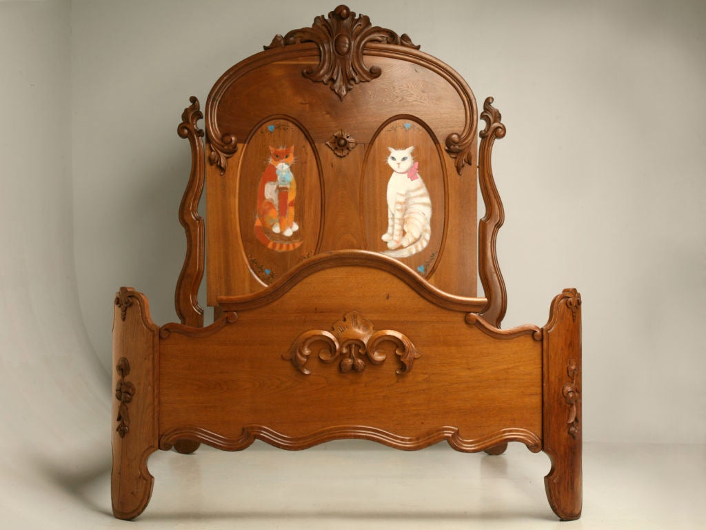 The kitties are here, looking for a young lady to watch over each night.  Decorated with walnuts, this amazing antique Victorian bed was made using some of the most beautiful woods available at the time, oak, walnut, and elm. During the last quarter