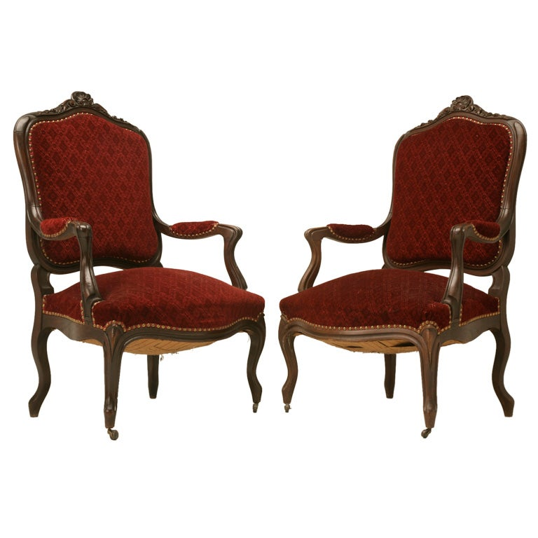 Exquisite Pair of Heavily Carved Antique French Louis XV Walnut Fauteuils