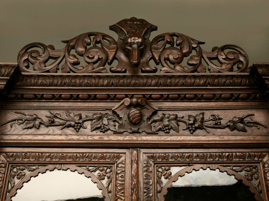Antique french heavily carved oak hunt cabinet with