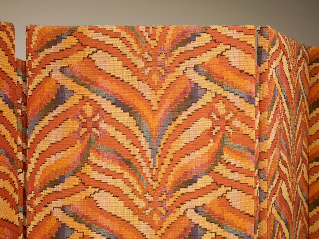 Outrageous custom-built high-quality five panel floor-screen/room divider upholstered in a rich tapestry with an interesting geometric inspired flame-stitch pattern. The color palette is warm and rich without overpowering ones senses, making it