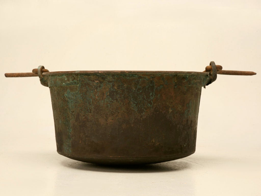 Awesome original antique French handmade copper cauldron with original hand wrought iron bail-form handle. This outstanding vessel retains its original patina from being used over a fire for more than 100 years. Though it could still be utilized for