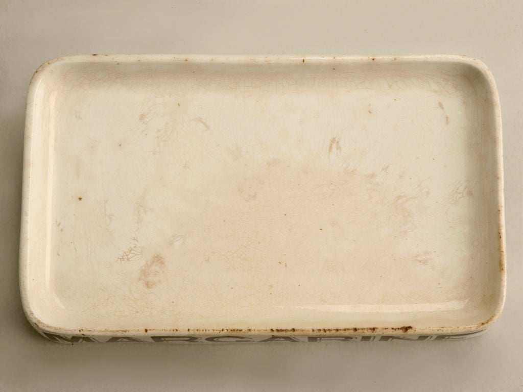 Original authentic antique English whiteware MARGARINE dairy slab. Utilized by grocers in the 1800's, these original dairy slabs are rare commodities in today's marketplace. Useful in modern homes today, our stores owner uses one at the bar for