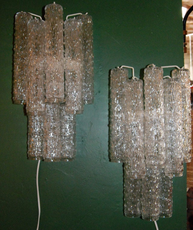Pair of large clear glass single light (each one) sconces.