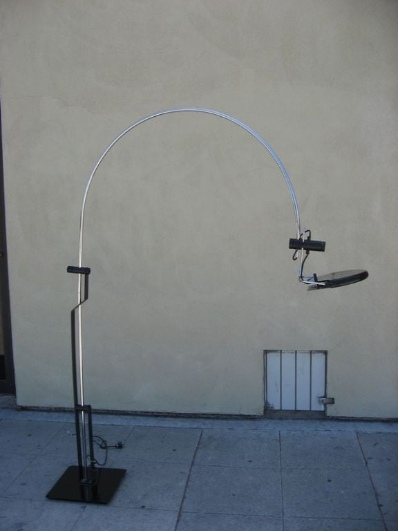 This Dutch arch floor lamp by Artmeta Soest is black enameled metal and chrome. The shade is adjustable in all directions.