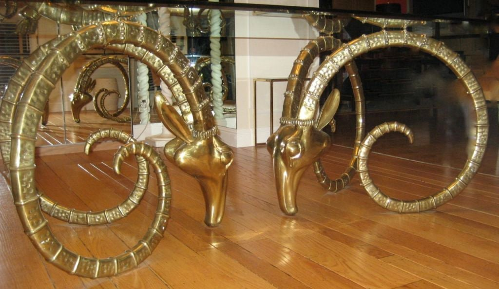 Merveilleux Large Pair Of Solid Brass Ibex Head Dining Table Bases.