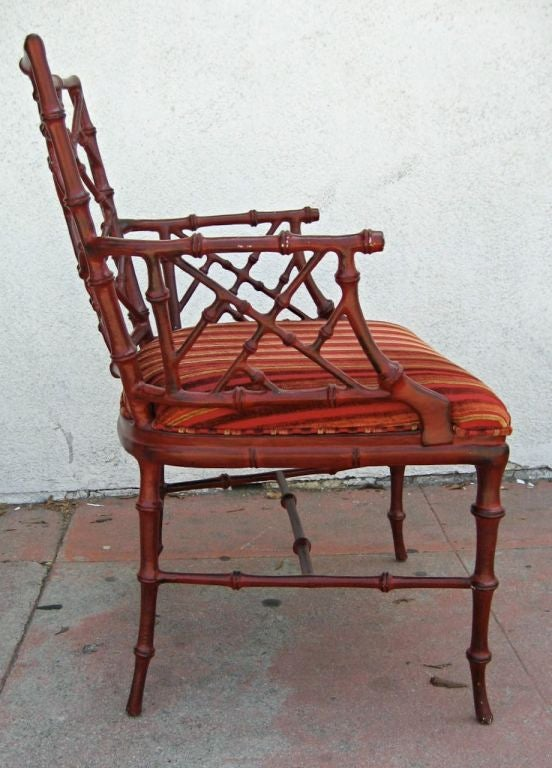Wonderfully detailed cast metal faux Bamboo armchair with upholstered slip seat by Phyllis Morris.