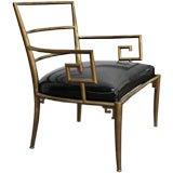 Italian brass armchair with Greek key armrests