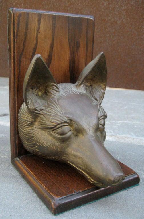 Cast bronze Fox heads mounted on hardwood.