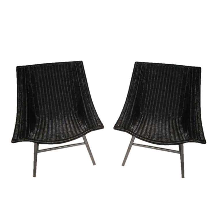 PAIR OF RETRO RATTAN AND METAL LOUNGE CHAIRS at 1stdibs