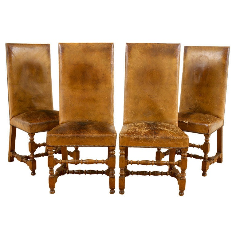 Four LXIII Style Walnut And Leather Upholstered Dining