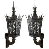 A pair of openwork bronze exterior lanterns